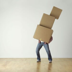 man struggling to hold boxes | Medicare Part B Excess Charges