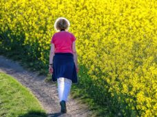 domestic violence qualifying life event special enrollment | woman walking away through flower field